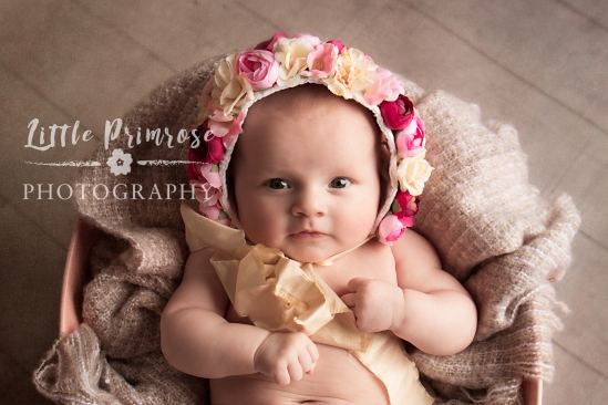 Most photographers won't photograph a baby between the age of 2 weeks and 6  months. We have a set regime of photo shoots – newborn, sitter and cake  smash.