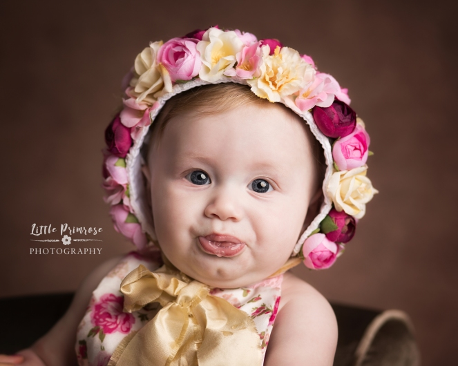 Sitter session at 6 months with floral bonnet