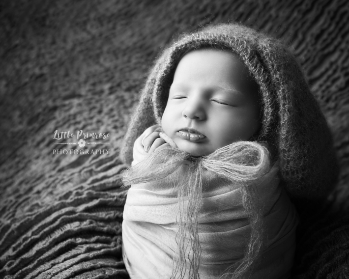 Newborn photography potato sack pose