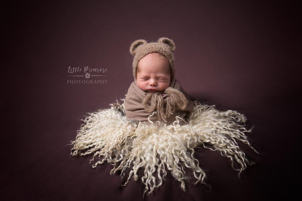 Newborn photography Cheshire - potato sack with Teddy bead ears