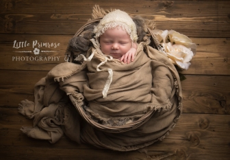 newborn baby photographer - Sandbach, Cheshire - basket prop and rustic bonnet with roses