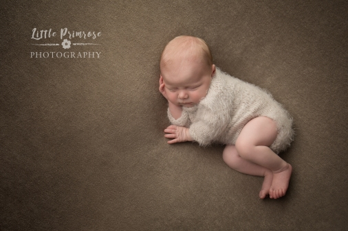 newborn baby photographer - Sandbach, Cheshire - baby girl in side pose