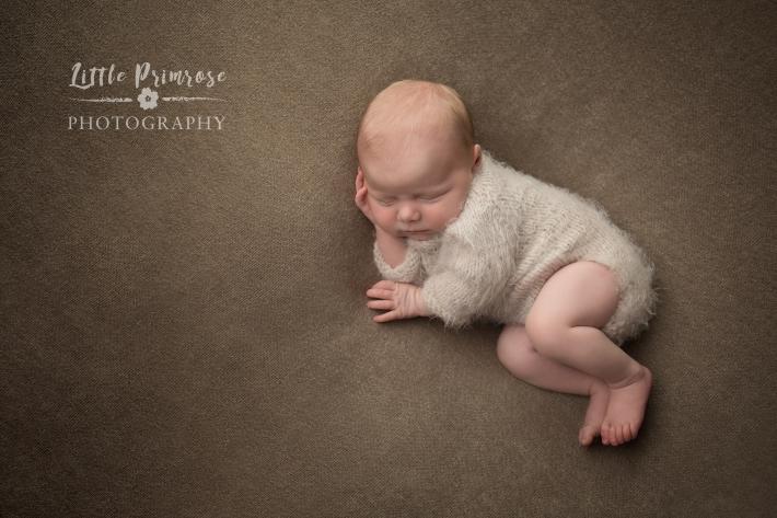 newborn baby photographer - Sandbach, Cheshire - baby girl in side pose